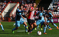 David Noble of Exeter City under pressure from Joe Jacobson of Wycombe Wanderers during the Sky Bet League 2 match between Exeter City and Wycombe Wanderers at St James' Park, Exeter, England on 26 September 2015. Photo by Pinnacle Photo Agency.