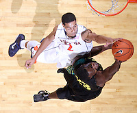 Dec. 17, 2010; Charlottesville, VA, USA; Oregon Ducks forward Jeremy Jacob (23) has his shot blocked by Virginia Cavaliers guard Mustapha Farrakhan (2) during the game at the John Paul Jones Arena. Virginia won 63-48. Mandatory Credit: Andrew Shurtleff-