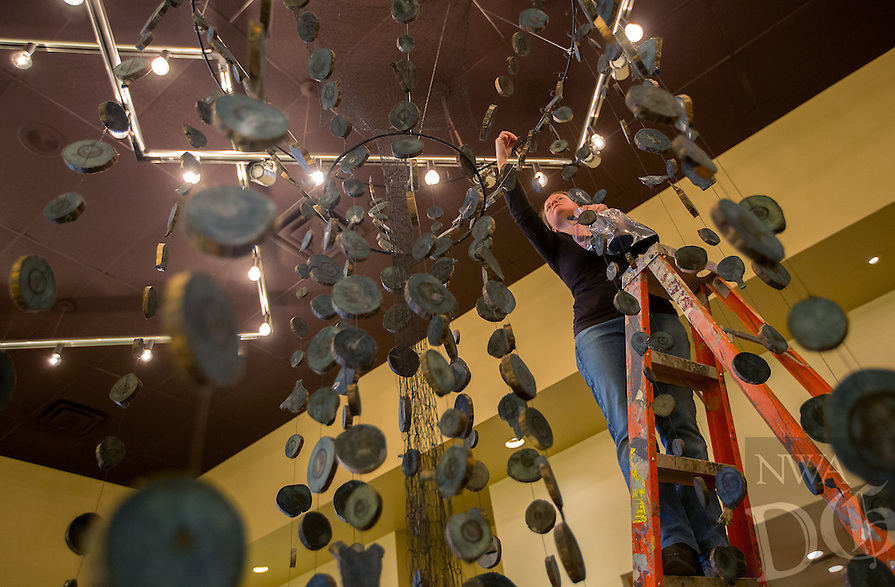 NWA Democrat-Gazette/JASON IVESTER --02/03/2015--<br /> Artist Heather Clark Hilliard of Norman, Okla., hangs her artwork titled, &quot;Memory Ring,&quot; on Tuesday, Feb. 3, 2015, inside the Arts Center of the Ozarks in Springdale. The Vox Femina art show, which features artworks from 12 female artists, opens Thursday and continues Feb. 26.