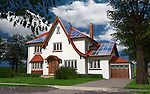 Detached family house with solar panels on the roof powered by solar energy. Sustainable development, renewable energy conceptual photo-realistc 3D illustration.