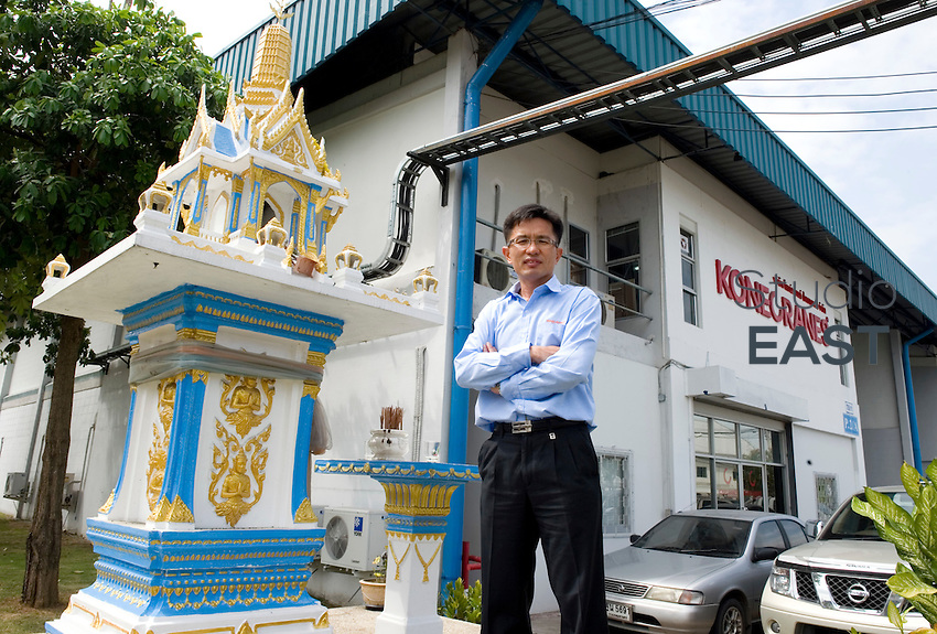 KoneCranes' Thailand Operation Manager Paiboon Kuhapermsub poses for a photograph in front of KoneCranes' offices in Pinthong Industrial Park, near Sriracha, Thailand, on November 10, 2010. Photo by Lucas Schifres/Pictobank