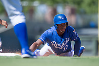 Kansas City Royals right fielder Seuly Matias (17) slides into first base on a pick-off attempt during an Instructional League game against the Cincinnati Reds on October 2, 2017 at Surprise Stadium in Surprise, Arizona. (Zachary Lucy/Four Seam Images)