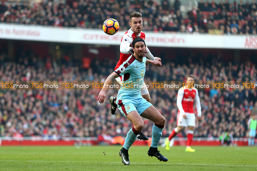 Aaron Ramsey of Arsenal and George Boyd of Burnley during Arsenal vs Burnley, Premier League Football at the Emirates Stadium on 22nd January 2017