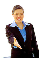 Successful business woman in business suit extending her hand to meet you.