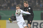 06.02.2019,  GER; DFB Pokal, Holstein Kiel vs FC Augsburg ,DFL REGULATIONS PROHIBIT ANY USE OF PHOTOGRAPHS AS IMAGE SEQUENCES AND/OR QUASI-VIDEO, im Bild Andre Hahn (Augsburg #28) versucht sich gegen Jannik Dehm (Kiel #20) durchzusetzen  Foto © nordphoto / Witke *** Local Caption ***