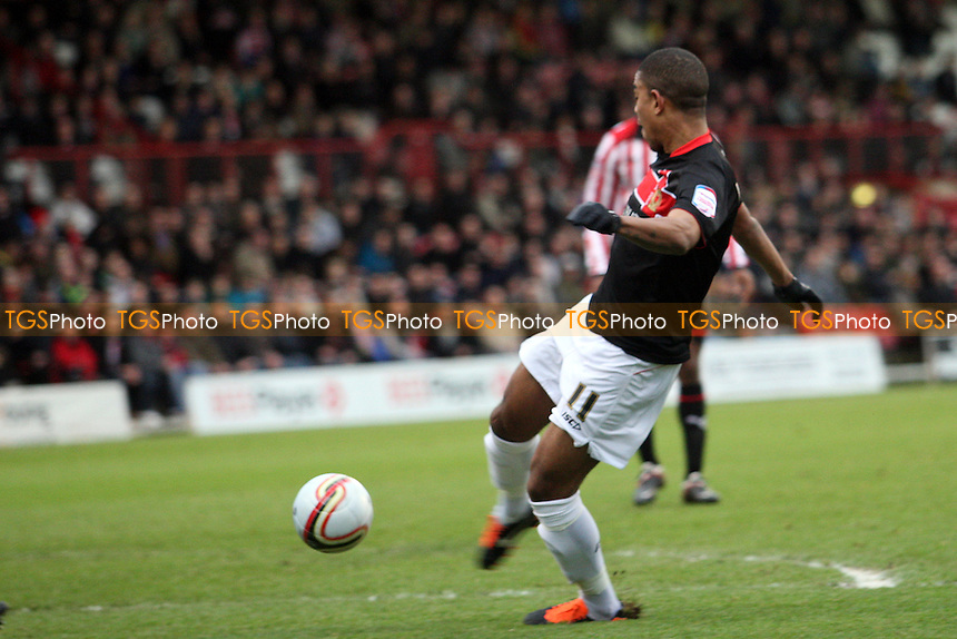 Angelo Balanta of MK Dons scores the second goal - Brentford vs MK Dons - at the Griffin Park Stadium - 31/12/11 - MANDATORY CREDIT: Dave Simpson/TGSPHOTO - Self billing applies where appropriate - 0845 094 6026 - contact@tgsphoto.co.uk - NO UNPAID USE.