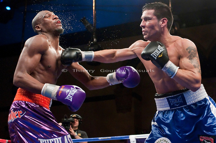 Atlantic City, NJ. Dec. 05, 2009: Sergio Martinez on the attack against Paul Williams  during their 12 Rounds middleweight fight at the Boardwalk Hall on Saturday, December 5th 2009. Williams won by a majority decision. Photos by Thierry Gourjon.