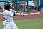 Reno Aces Jake Elmore slams an RBI triple in the first inning agianst the Albuquerque Isotopes during their game on Friday night August 10, 2012 at Aces Ballpark in Reno NV.