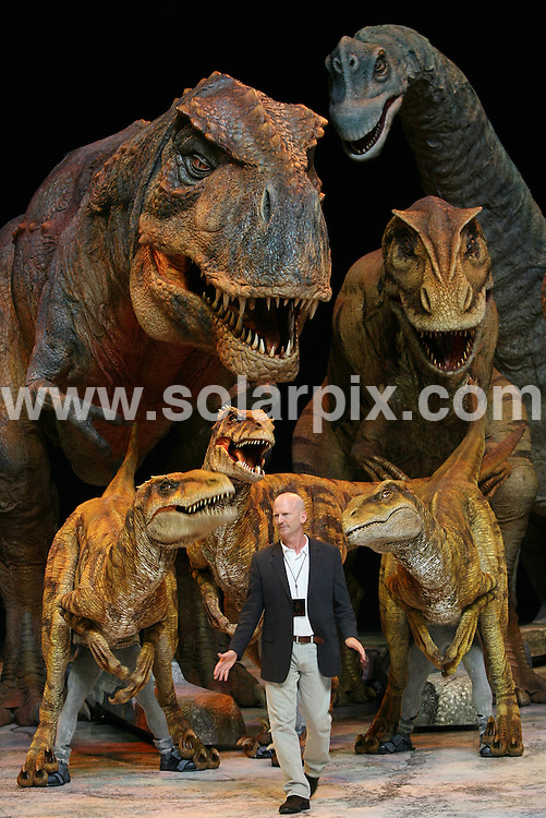 **ALL ROUND PICTURES FROM SOLARPIX.COM**.**WORLDWIDE SYNDICATION RIGHTS**.Paleontologist Dominic Rickards, and Director Rob Carroll have fun playing with The Walking With Dinosaurs at the 02 Arena in North Greenwich, London on Wednesday 5th August 2009. ..The Arena Spectacular, based on the award-winning BBC Television series sees real size dinosaurs come to life in what promises to be one of the most exciting and groundbreaking shows ever seen in the U.K. Internationally renowned designers have worked with scientists to create 15 life-size dinosaurs, including the terror of the ancient terrain, Tyrannosaurus-rex. ..This pic: Walking With Dinosaurs..JOB REF: 9699 LNJ     DATE: 05_08_2009.**MUST CREDIT SOLARPIX.COM OR DOUBLE FEE WILL BE CHARGED**.**MUST NOTIFY SOLARPIX OF ONLINE USAGE**.**CALL US ON: +34 952 811 768 or LOW RATE FROM UK 0844 617 7637**