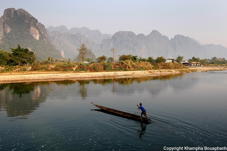 A resident crosses Nam Song in Vang Vieng, Laos on Tuesday, March 4, 2008.  Now a popular stop for backpackers, Air America's planes used its airstrip during the Vietnam War.  (photo by Khampha Bouaphanh)