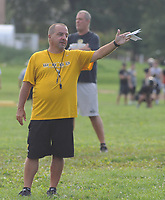 Archbishop Wood's head coach Steve Devlin gives orders to his players during football practice Thursday, August 10, 2017 at Archbishop Wood in Warminster, Pennsylvania. (Photo by William Thomas Cain)