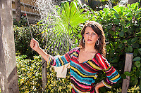 Dezree MacDonough keeps cool at Vanderbilt Beach Resort in a striped Petit Pois cover-up, available at mypetitipois.com, Petunia's on Fifth Ave., and other area shops, at Vanderbilt Beach Resort, Naples, July 27, 2012. Photo by Debi Pittman Wilkey/Coastal Life Magazine.