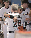 (B-F) Ichiro Suzuki, Dan Jennings (Marlins), MAY 18, 2015 - MLB : Miami Marlins batter Ichiro Suzuki (back) hugs Manager Dan Jennings (front) after presenting a necktie during the major league baseball game against the Arizona Diamondbacks at Marlins Park in Miami, United States. (Photo by AFLO)