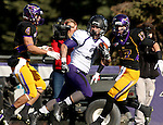 MANKATO, MN - NOVEMBER 1:  Nephi Garcia #3 for the University of Sioux Falls looks back while running down the sideline between Nathan Hancock #4 and Justin Otto #17 from Minnesota State Mankato in the first quarter Saturday afternoon at Blakeslee Stadium in Mankato. (Photo by Dave Eggen/Inertia)