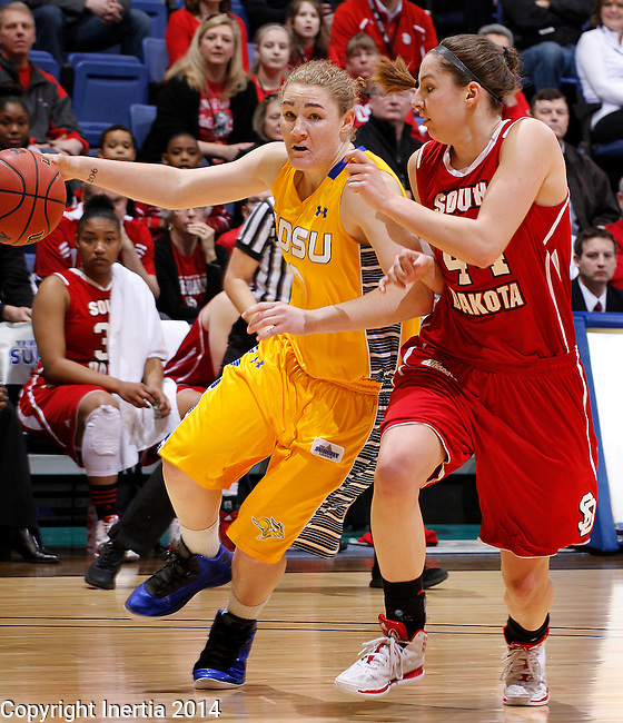 SIOUX FALLS, SD - MARCH 10:  Chynna Stevens #0 of South Dakota State drives past Lisa Loeffler #44 of South Dakota during their semifinal game at the 2014 Summit League Basketball Championships at the Sioux Falls Arena Monday.  (Photo by Dick Carlson/Inertia)