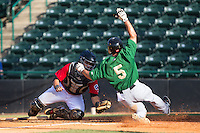 Patrick Biondi (5) of the Savannah Sand Gnats is tagged out at home plate by Hickory Crawdads catcher Jose Trevino (7) at L.P. Frans Stadium on June 14, 2015 in Hickory, North Carolina.  The Crawdads defeated the Sand Gnats 8-1.  (Brian Westerholt/Four Seam Images)