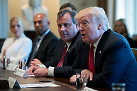 US President Donald J. Trump (R), with New Jersey Governor Chris Christie (2-R), Former New York Yankee great Mariano Rivera (2-L) and Florida Attorney General Pam Bondi (L), delivers remarks during an opioid and drug abuse listening session in the Roosevelt Room of the White House in Washington, DC, USA, 29 March 2017. Photo Credit: Shawn Thew/CNP/AdMedia