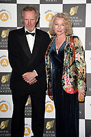 LONDON, UK. March 19, 2019: Nicholas Farrell & wife Stella Gonet arriving for the Royal Television Society Awards 2019 at the Grosvenor House Hotel, London.<br /> Picture: Steve Vas/Featureflash