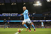 3rd December 2017, Etihad Stadium, Manchester, England; EPL Premier League football, Manchester City versus West Ham United; David Silva of Manchester City crosses the ball as Arthur Masuaku of West Ham pressures