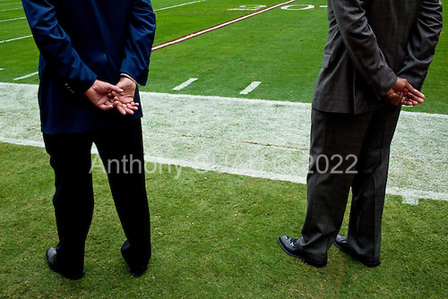 Houston, Texas<br /> October 2, 2011<br /> <br /> The hands of team owner Bob McNair (blue jacket) and general manager and first as executive vice president, Rick Smith (grey jacket) as they watch from the sidelines during the game. <br /> <br /> The Houston Texans defeated the Pittsburgh Steelers at the Reliant Stadium 17 to 10.