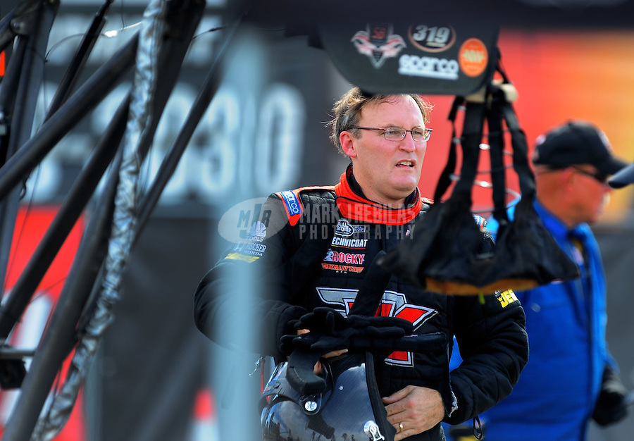Nov. 13, 2011; Pomona, CA, USA; NHRA top fuel dragster driver Doug Kalitta during the Auto Club Finals at Auto Club Raceway at Pomona. Mandatory Credit: Mark J. Rebilas-.