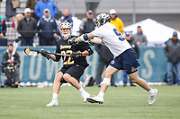 Washington, DC - February 23, 2019: Towson Tigers Timmy Monahan (22) gets checked by Georgetown Hoyas Patrick Aslanian (9) during game between Towson and Georgetown at  Cooper Field in Washington, DC.   (Photo by Elliott Brown/Media Images International)
