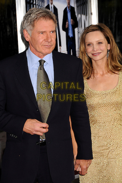 "HARRISON FORD & CALISTA FLOCKHART.""Extraordinary Measures"" Los Angeles Premiere held at Grauman's Chinese Theatre, Hollywood, California, USA..January 19th, 2010.half length couple black suit jacket gold beige beads beaded dress chainmail .CAP/ADM/BP.©Byron Purvis/AdMedia/Capital Pictures."