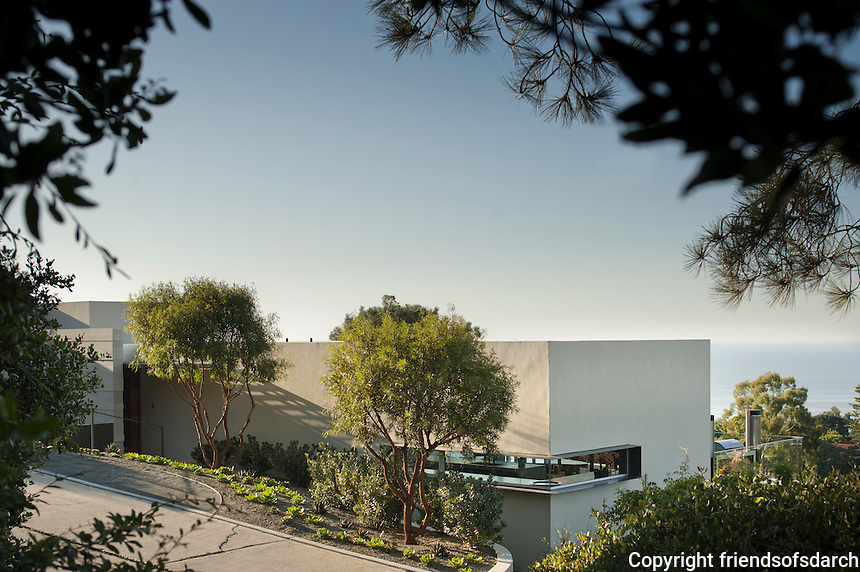 Kafka Residence in La Jolla, 2011. Hillside residence with views of Pacific Ocean. Native plants and blue green succulents complement the architecture. Specimen aloes placed in front of prominent walls. <br />