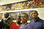 "Artist Reception for Seeing with Photography Collective SWPC, a group of visually impaired, sighted and totally blind photographers based in NYC, on Saturday, April 28, 2012, at African American Museum, Hempstead, New York, USA. Dale Layne, Tameka Cooper, Marion Sheppard, and Hasheem Kirkland (left to right), vision impaired or blind SWPC photographers are in front of ""Untitled Panorama"" and ""Blind Train.""  Evhibit was hosted by Long Island Center of Photography. Aperture published the group's ""Shooting Blind: Photographs by the Visually Impaired"" in 2005."