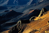 Warm glow of sunrise highlights the crater in HALEAKALA NATIONAL PARK on Maui in Hawaii