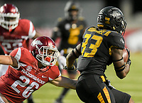 NWA Democrat-Gazette/CHARLIE KAIJO Arkansas Razorbacks defensive back Ryder Lucas (26) reaches over to tackle Missouri Tigers running back Larry Rountree III (33) in the second half during a football game on Friday, November 24, 2017 at Razorback Stadium in Fayetteville.