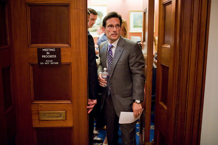 UNITED STATES - JULY 06:  House Majority Leader Eric Cantor, R-Va., leaves his weekly pen and pad briefing with reporters in the Capitol where he answered a number of questions on the debt ceiling debate. (Photo By Tom Williams/Roll Call)