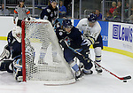 SIOUX FALLS, SD - OCTOBER 17:  Lawton Courtnall #14 from the Sioux Falls Stampede battles for the puck with Tommy Muck #14 behind goalie Garrett Metcalf #30 from the Madison Capitols in the first period Friday night at the Denny Sanford Premiere Center. (Photo/Dave Eggen/Inertia)