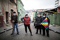 La Paz, Bolivia<br /> Wednesday November 13, 2019<br /> A group of civil guardians pose for a picture near the Gobernment Palace in the Capital city of La Paz.  After the October 20 presidential elections and resignation of President Evo Morales, there is a lot of protests in many regions of Bolivia.