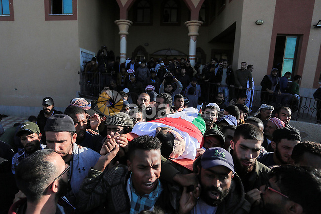 Mourners carry the body of the Palestinian, Mohammed Abu Malhous,40, who was died today 22 November 2019, affected of his injuries when his house was targeted by the Israeli air strike and killed 8 of his family, on 14 Nov 2019. Photo by Ashraf Amra