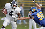 Georgia Southern quarterback Jayson Foster (4) eludes South Dakota State tackler Jason Nobiling (90) for a short gain in the first half of their game Saturday October 29, 2005 at Coughlin Alumni Stadium in Brookings, S.D. (Photo by Dick Carlson/Inertia)