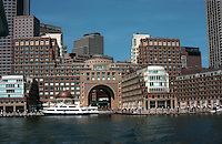 Boston:  Rowes Wharf Complex. Architect Adrian Smith, Chicago office of S-O-M, 1988. Double-arched portico offers entrance from sea to city.  Classical but modern design.  In background, left, International Place by Burgee-Johnson.  Photo '88