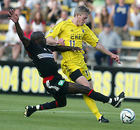 D.C. United's John Wilson (left) fouls Columbus Crew's John Wolyniec (right) during their game in Columbus, Ohio, Saturday, July 2, 2005.