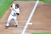 Efren Navarro (16) of the Salt Lake Bees hustles towards home plate against the Fresno Grizzlies at Smith's Ballpark on April 9, 2014 in Salt Lake City, Utah.  (Stephen Smith/Four Seam Images)