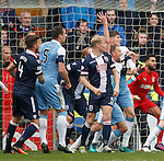 Clint Hill boxed in for the Ross County goal