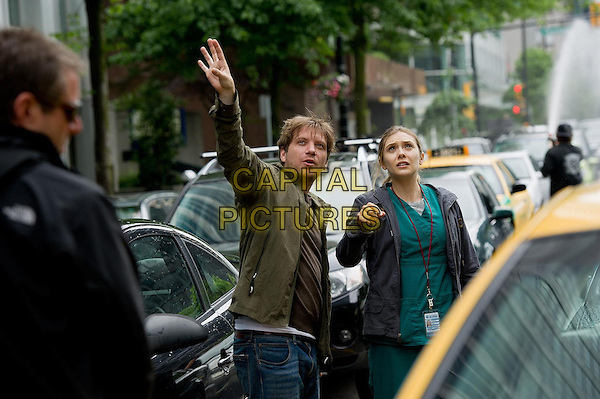 Gareth Edwards (Director), Elizabeth Olsen <br /> on the set of Godzilla (2014)<br /> *Filmstill - Editorial Use Only*<br /> CAP/NFS<br /> Image supplied by Capital Pictures