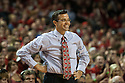 December 4, 2013: Head coach Tim Miles of the Nebraska Cornhuskers smiles after Tai Webster made a free throw against the Miami (Fl) Hurricanes at the Pinnacle Bank Areana, Lincoln, NE. Nebraska defeated Miami 60 to 49.