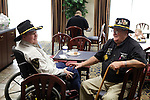 B Troop 1/9th Cavalry Pilot Ray Arnold, left, and B Troop 1/9th Cavalry Sgt. Fletcher talk during the Gathering of Warriors reunion attended by Vietnam War Veterans of the 1st Squadron, 9th Cavalry, 1st Cavalry Divison.
