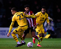 Lincoln City's Liam Bridcutt is fouled by Milton Keynes Dons' Carlton Morris<br /> <br /> Photographer Andrew Vaughan/CameraSport<br /> <br /> The EFL Sky Bet League One - Lincoln City v Milton Keynes Dons - Tuesday 11th February 2020 - LNER Stadium - Lincoln<br /> <br /> World Copyright © 2020 CameraSport. All rights reserved. 43 Linden Ave. Countesthorpe. Leicester. England. LE8 5PG - Tel: +44 (0) 116 277 4147 - admin@camerasport.com - www.camerasport.com