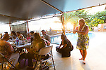 Friday nights at the Hotel Molokai hosts Na Kupuna where people gather casually to play music and dance hula on the island of Molokai, Hawaii, USA