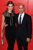 """NEW YORK, NY - NOVEMBER 20: Felicity Blunt, Stanley Tucci at the New York Premiere Of Lionsgate's """"The Hunger Games: Catching Fire"""" held at AMC Lincoln Square Theater on November 20, 2013 in New York City. (Photo by Jeffery Duran/Celebrity Monitor)"""