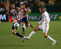 LA Galaxy midfielder David Beckham (23) and Chivas forward Ante Rozov (9) battle for a loose ball. CD Chivas USA defeated the LA Galaxy 3-0 in the Super Classico MLS match at the Home Depot Center in Carson, California, Thursday, August 23, 2007.