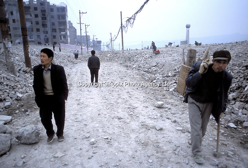 Residents walk through the rubble of Fengdu, China..21-JAN-03