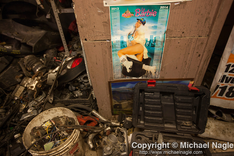 QUEENS, NY -- OCTOBER 25, 2013: Piles of car parts sit next to a pin-up poster at SCDC Scrap Metal Inc. in Willets Point on October 25, 2013 in Queens, NY.  PHOTOGRAPH  BY MICHAEL NAGLE FOR THE NEW YORK TIMES
