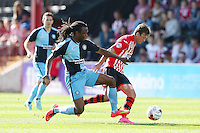 Lee Holmes of Exeter City gets away from Marcus Bean of Wycombe Wanderers during the Sky Bet League 2 match between Exeter City and Wycombe Wanderers at St James' Park, Exeter, England on 26 September 2015. Photo by Pinnacle Photo Agency.
